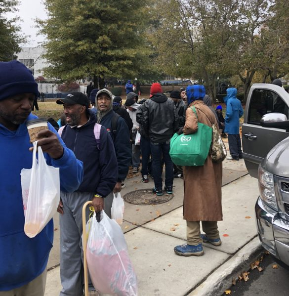 Passing out toiletries to the community with Love Gives Ministries